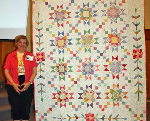 "Barbara Smith created and quilted ""Friendship"" from 'Granny's Stars' pattern from Fons & Porter's magazine 2009.   She made this from fabric given her by her friends!"
