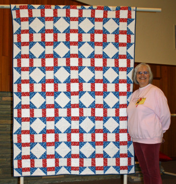 Connie Emmen used Churn Dash blocks to create & quilt this Quilt of Valor.