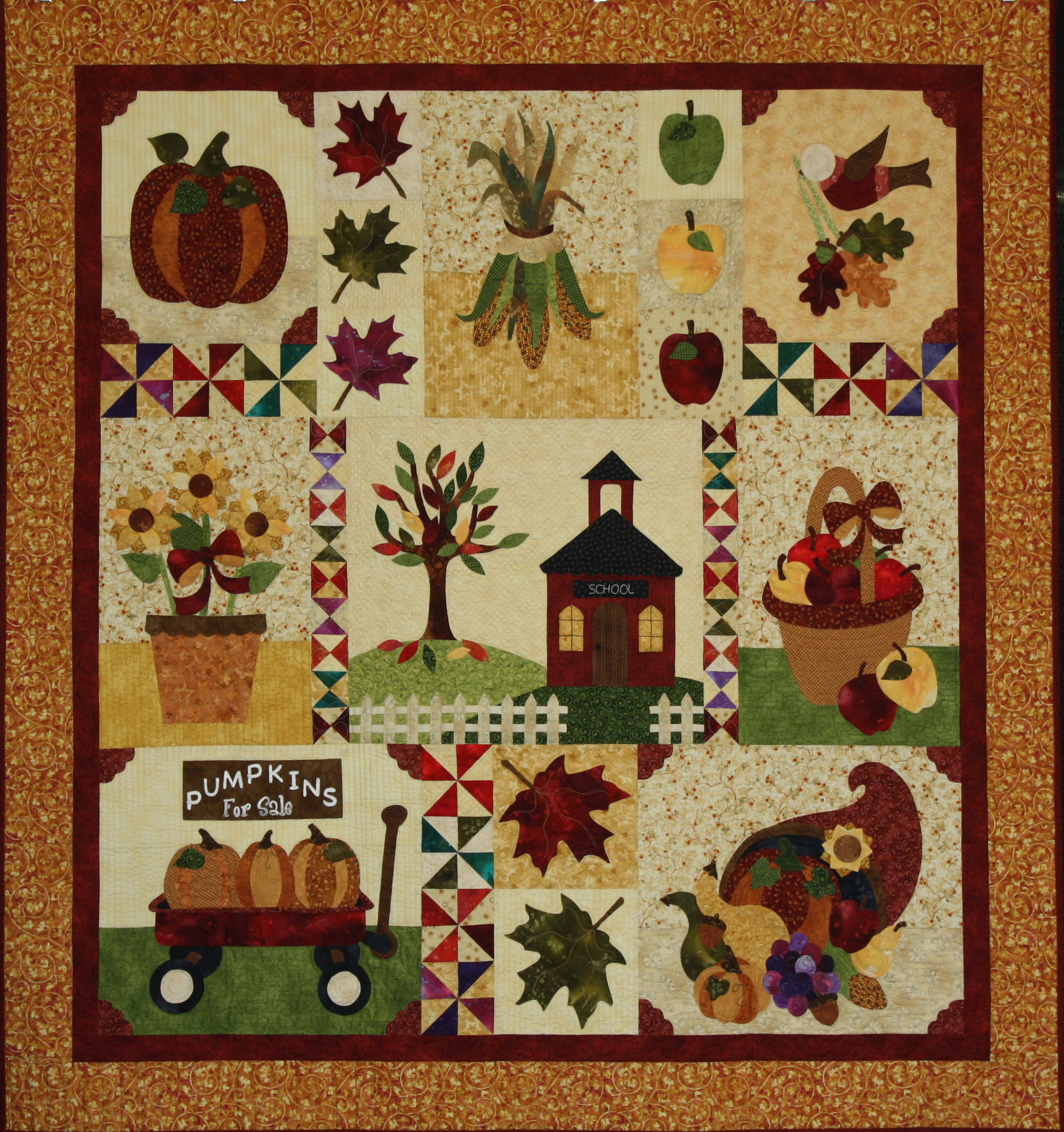 """Blessings of Autumn"" won First Place Small Pieced Quilt by Two People. This was created by Cheryl Little and quilted by Jami Herndon."