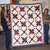 "This is a sample of quilts made at the February ""Sew-in"" for the Quilts of Valor. Five quilt tops were assembled as a result of the volunteers."