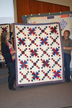 """This is a sample of quilts made at the February """"Sew-in"""" for the Quilts of Valor. Five quilt tops were assembled as a result of the volunteers."""