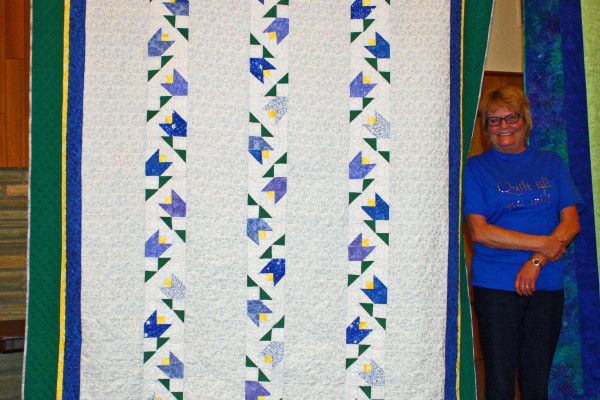 "Sue Kreger is a member of a three-person group, ""Suelalaine""  in which last year they created Mystery Quilts. Each month they learn something new!  All three quilts used the same pattern with slightly different settings."
