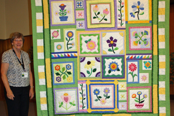 "A ""Stitcher's Garden"" was created by Susan Pirrong and Quilted by Terry Hill from a Block of the Month studying applique' at the Quilt Crossing."