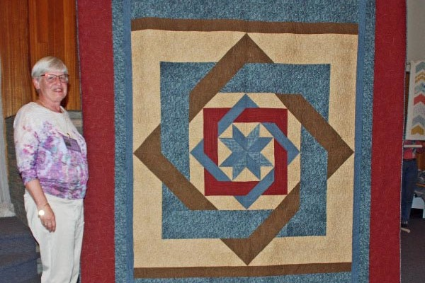 "Aleida Houdyshell created this ""Labyrinth"" quilt from Calico Carriage Quilt Designs, and Terri Hair quilted it.  She found the flannel fabric on a recent trip to Salt Lake City."