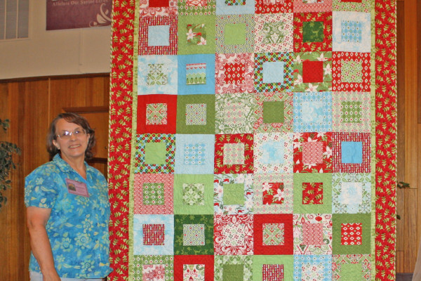 """Layer Cake Christmas"" is made & quilted by Maureen Stevens.  This is made from a Layer Cake and a Quilt Expressions pattern."