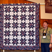 "This Quilt of Valor, ""Traditional Variable Star"", was created by Esther Kleinkauf and quilted by Connie Emmen."