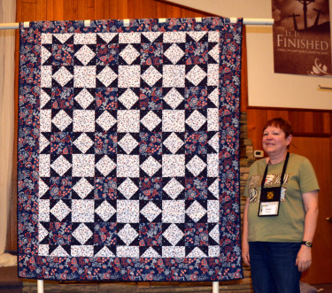 """This Quilt of Valor, """"Traditional Variable Star"""", was created by Esther Kleinkauf and quilted by Connie Emmen."""