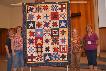 """This Quilt of Valor, """"Sampler Star"""", was created by the small group Friday Nooners, and quilted by Connie Emmen."""