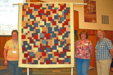 """This Quilt of Valor, """"Split 9-Patch was made by the small group Piece Corp and quilted by Connie Emmen."""