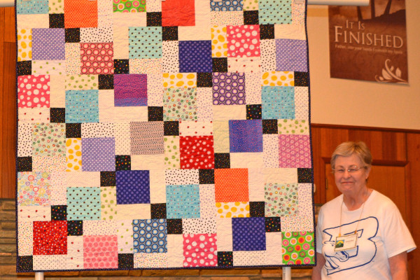 """Lots of Dots"" is a disappearing 9-patch, created by Sandra Rogers & quilted by Danette Kroft."