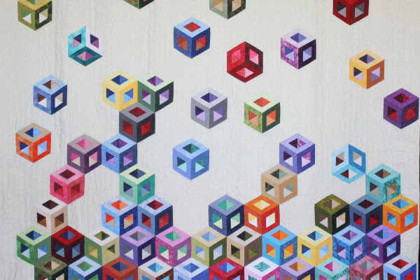"""Tumbling Blocks My Way"" by Margie Braach, first Place in Viewers Choice and first in Large Pieced by One"