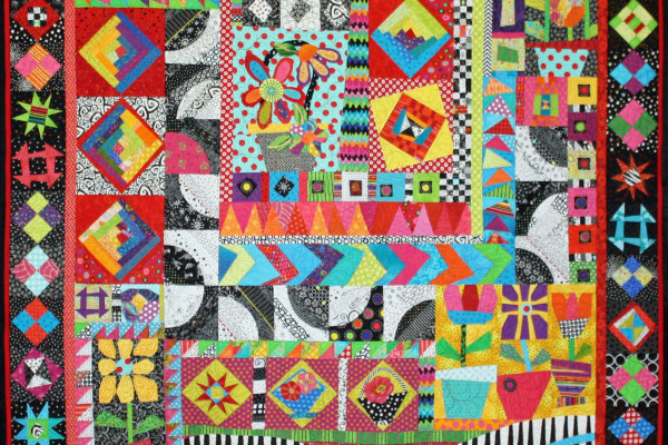"""""""Bat S*** Crazy""""  by Debra Barnes, quilted by Yvette Ebaugh, first place for Large pieced quilt by two"""