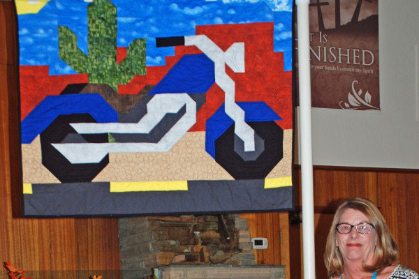 """This crib quilt """"Rowdy Rider"""" was created & quilted by Cindy Schroeder from a pattern """"Motorcycle"""", by Quilt Woman."""