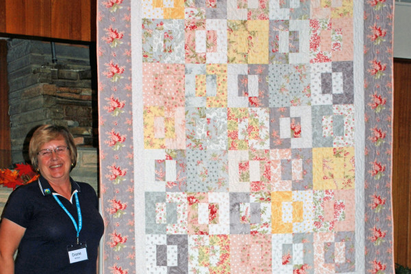"""Summer Memories"" was created by Diane Wilton & quilted by Connie Emmen from the pattern Split Decision."