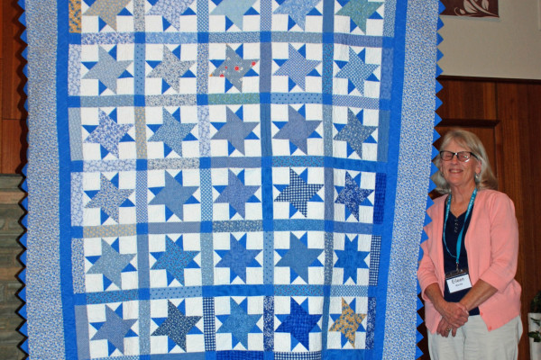"""Eileen Wardle presented & quilted """"Blues"""" from star blocks made by friends in the """"Piece in the Valley"""" quilt group."""