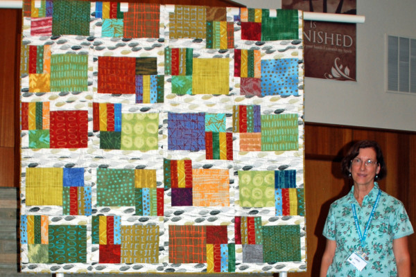 """Linda Jolly created and quilted """"Farmer's Market"""" from a fun pattern """"Flower Stalls'"""