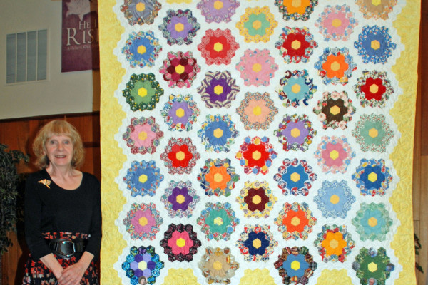 """""""My Grandmother's Flower Garden"""" was made by Lona Schuster & quilted by Quilt Expressions.  Six generations of the Gray family pieced this quilt together, starting in 1872-74."""