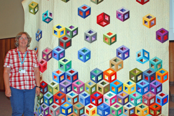 """""""Tumbling Blocks, My Way"""" was created and quilted by Margie Braach, using 8"""" squares of assorted tone-on-tone fabrics from BBQ Fabric Exchange."""