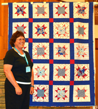 """This """"Quilt of Honor"""" from Fons & Porter was made by Maryon Evans and quilted by Connie Emmen for the female Veterans presentation at the Quilt Show."""