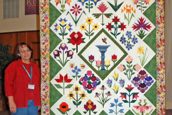 """Maureen Stevens created and quilted this """"Garden Party"""" from 12 of her own designed blocks for the Quilters Runway."""