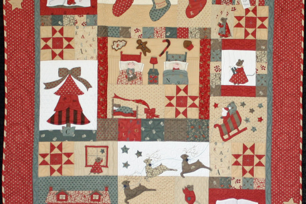 """""""Night Before Christmas"""" by Mary Ellen Stringhan, took  first place, Small Applique by two; Melanie Shreeve as quilter"""