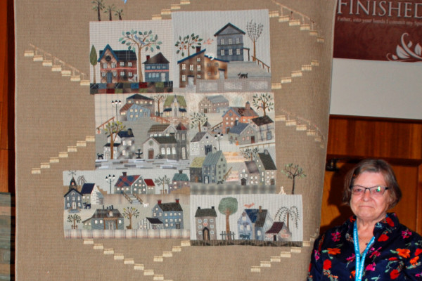 """""""Welcome to My Neighborhood"""" was made by Patty Henry when a friend gave her this quilt kit.  It is the design of Yoko Saito and is hand quilted by Patty herself."""