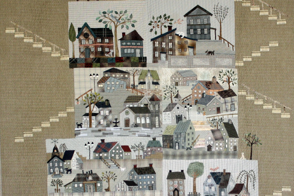 """""""Welcome to My Neighborhood"""" by Patty Henry; first place in Small Applique by One person, the Camille Morris Award for Best Use of Plaids, and the National Quilting Association Merit Award."""