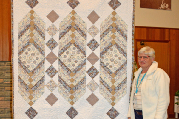 """leida Houdyshell made """"Perfect Harmony"""" and Teri Hair quilted it.  The pattern is from Fons & Porter.  Aleida purchased the material on a cruise to Australia and New Zealand.  What a great memory!"""