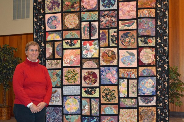 """Barbara Smith's """"Circles of the Orient"""" is made with reverse machine applique.  Quilted by Jude Rappell."""