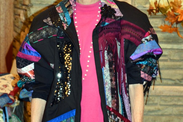 Cheryl Little owns this 1990s jacket, made by Oregon Treasures and the owners Barb Shefield & Bev Vickery, as a thank you.  Note the glasses are the real 1990's era!  She carried a Serenity Cell Phone Purse by Celia Roberts that is not pictured here.