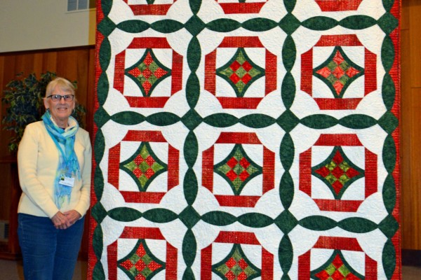 """Eileen Wardle, ccreated & quilted """"Christmas Nine Patch"""" , inspired by Julia Ziegler's Schoolhouse class on the Quick Curve Ruler.  This is from a book, """"Sew kind of Wonderful - Curve it Up"""""""