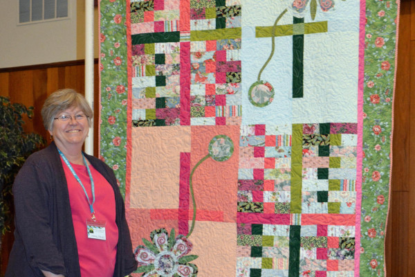 """Karen Falvey created & quilted """"Outback-Fantasy Flower"""" from the pattern """"outback"""" and fused applique.  These were made with her Go Cutter and the Fantasy Flower die."""