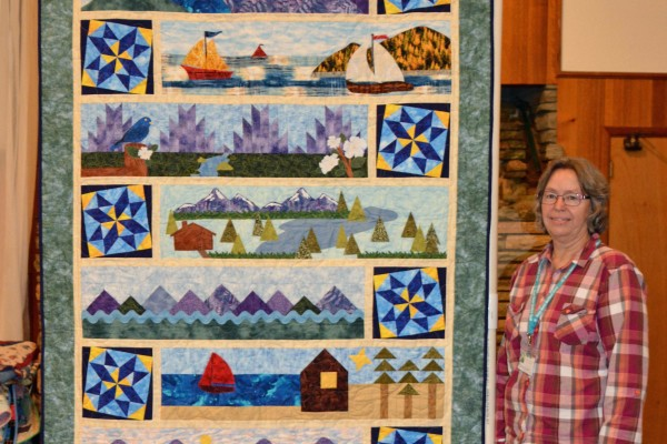 """Margie Braach created & quilted """"Row by Row Mountains"""" for the over 50 quilt shops she collected patterns from this summer!"""