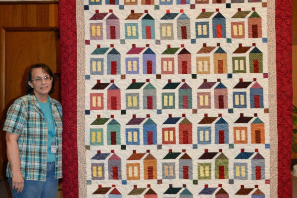 """""""Kathy's House's"""" was started by Kathy Longstroth.  Maureen Stevens added 18 more house blocks, put it together and quilted it for her.  Maureen will give it to her now that it is finished."""