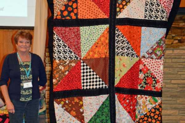Sue Kreger's friend's dog died after 18 years.  She saved all the bandanas from visits to the vet.  This quilt is from the bandanas.
