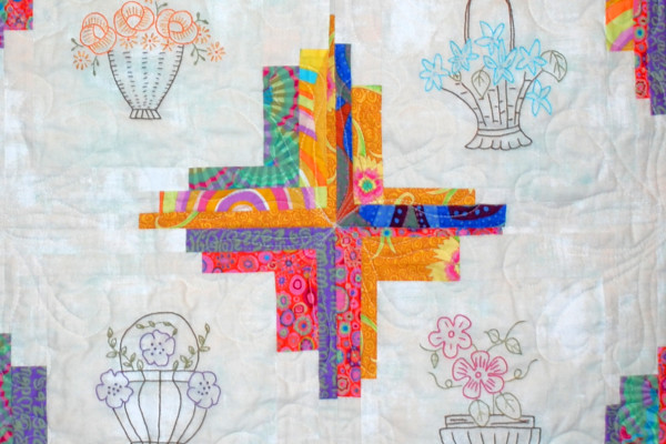 """Close-up section of """"Flower Baskets"""" by Margie Braach, made with embroidered blocks from the Block of the Month program at BBQ"""