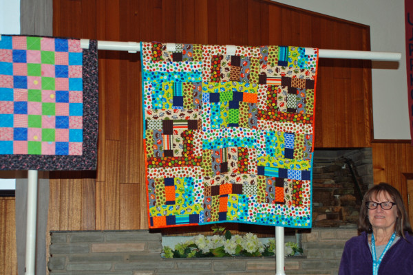 Joleen Graham has 2 quilts she made and quilted - Emma's doll quilt and Corwin's quilt, from a Jelly Roll Jam II pattern.