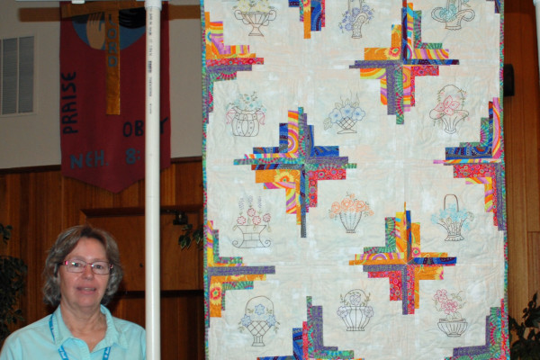 """""""Flower Baskets"""" made & quilted by Margie Braach is from embroidered block from the BBQ Block of the Month several years ago."""