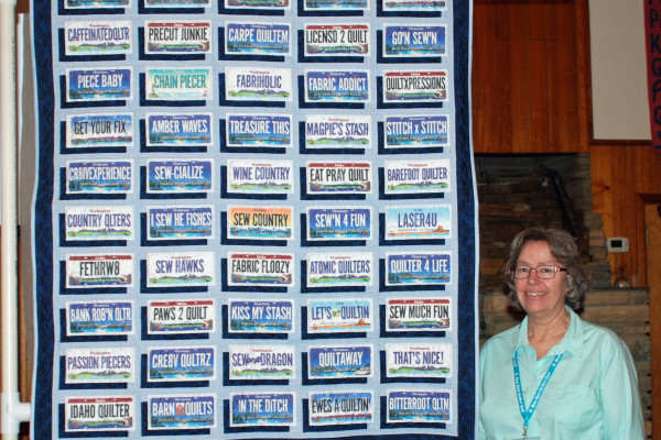 """""""License Plate Quilt"""" made & quilted by Margie Braach resulted from 50 shops in Idaho, Montana, and Wyo."""