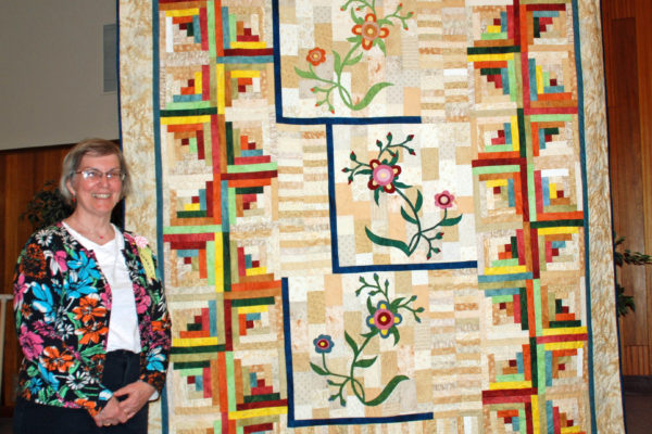 """""""Fantasy Flowers"""" was made & quilted by Barbara Smith from the """"Primitive Quilts"""" magazine, Spring 2015."""