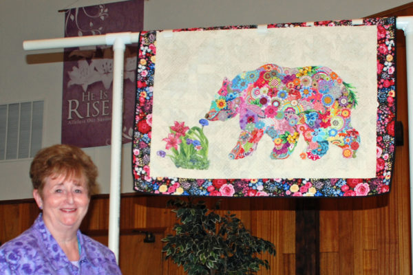 """""""Pansies, Petunias, & Bears, Oh My!"""" was created & quilted by Carol Herbst."""