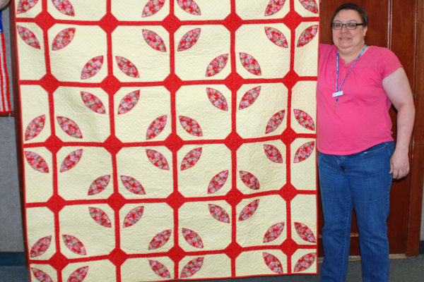 """""""Lotus Leaves"""" was created by Carol McClain and quilted by Darci Mead, as a donation to FACES."""