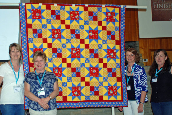 This original, French Country quilt was created by the Cathedral of the Rockies Quilters for a donation.