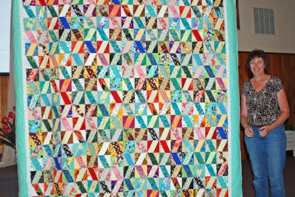 """""""Zig Zag Riot"""" was created & quilted by Chris Klover."""