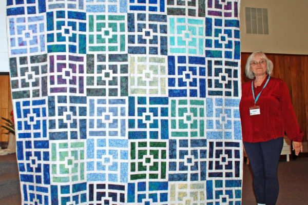 """""""Huckleberry Wine"""" was created & quilted by Connie Emmen in honor of her niece."""