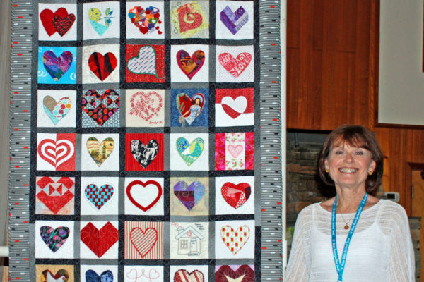 """""""I Love My Friends made by Dixie Johnson, et. al, quilted by Jamie Herndon, was an original; 6 1/2 in blocks created by friends."""