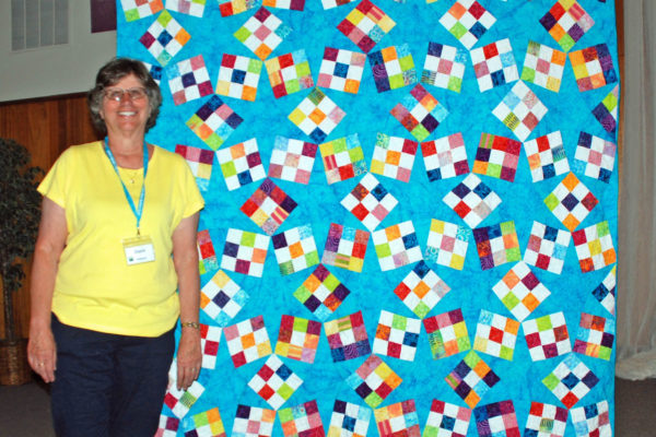 """""""Stars and Nines"""" by Joyce Thompson was pieced with challenging Y seams. Pattern from  Fons & Porters Scrap Quilts 2014"""
