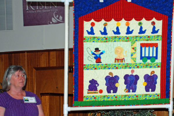 """""""Everett's Circus Quilt"""" made & quilted by Kathy England as a combination of patterns."""