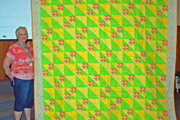 """""""Lemon Lime with a Splash of Orange"""" was created by Kenna Worthington & quilted by Quilt Expressions from an Accu-quilt Pattern."""