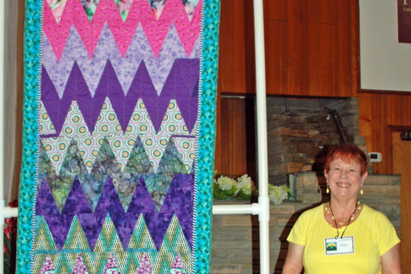 """""""Zig Zag"""" was created by Marie Lee & quilted Carol Hill."""